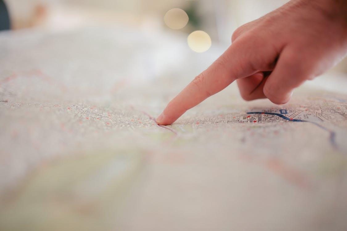 Person Pointing on White Textile