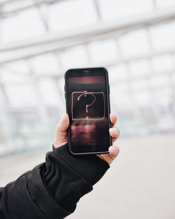 Person Holding Black Iphone